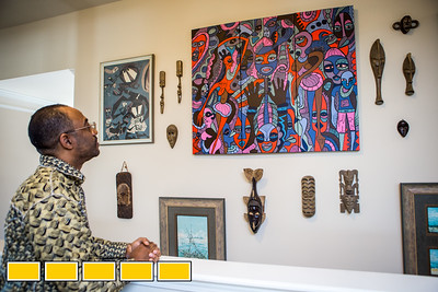 Jean-Patrick Guichard is a long-time collector of African art, he is at his Fairburn home, and plans a gallery opening in metro Atlanta in 2018.  The painting is the center is a piece created by a Kenyan painter specifically for Guichard.  Guichard was born in New York and raised in West Africa and has pieces passed down from his mother as well as an expansive set of paintings, sculpture, ceremonial masks and artifacts he has secured through years of searching.  Many of the works are early works of now prolific and well known artists.  Guichard begins relationship at art school and art communities in Africa.  (Jenni Girtman / Atlanta Event Photography)