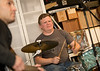 Neighbors, band mates and friends practice in the garage of the drummer, Elliott Danger, who is an estimator in commerical HVAC.  The group hopes to book local breweries and play events in their time off from their day jobs.  (Jenni Girtman / Atlanta Event Photography)