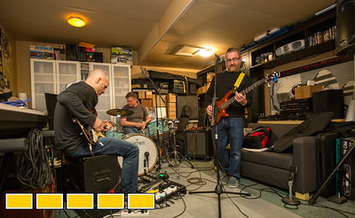 Neighbors, band mates and friends practice in the garage of the drummer, Elliott Danger, Center back, who is an estimator in commerical HVAC.  Guitar player Brian Creekmur, left, works in IT and bass guitarist and vocalist Brian Pollack, right, is a Physician Scientist.  The group hopes to book local breweries and play events in their time off from their day jobs.  (Jenni Girtman / Atlanta Event Photography)