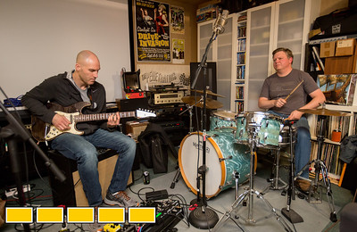 Neighbors, band mates and friends practice in the garage of the drummer, Elliott Danger, right, who is an estimator in commerical HVAC.  Guitar player Brian Creekmur, left, works in IT and bass guitarist and vocalist Brian Pollack is a Physician Scientist, off camera.  The group hopes to book local breweries and play events in their time off from their day jobs.  (Jenni Girtman / Atlanta Event Photography)
