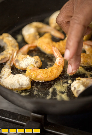 """Chef Todd Richards has his first cookbook """"Soul"""" now available.  The beautiful hardback is filled with families stories, food recipes and great photography.  Richards makes Shrimp Hot Chicken-Style at his Atlanta home.  (Jenni Girtman / Atlanta Event Photography)"""