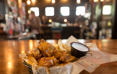 Barrelhouse, an American Pub in Midtown, is a regular spot for Georgia Tech staff and students.  The restaurant serves a basket of chicken wings with fries and is conveniently located in Tech Square at 22 5th Street.  (Jenni Girtman / Atlanta Event Photography)