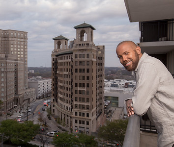 Cranston Collier lives in his Midtown condo at The Windsor Over Peachtree at the corner of North Ave and Peachtree Street on the edge of Midtown.  The view from Collier's balcony overlooks the Fox Theater and has a view of Poce City Market from the 15th floor of the complex.  (Jenni Girtman / Atlanta Event Photography )