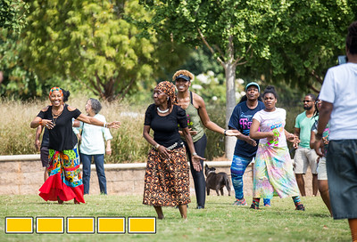 Toni Marie Young, center, brown skirt, leads a Class on the Grass where she teaches traditional African dance during an Art on the Beltline event.  The Beltline activites now extends to the Westside Trail where family-friendly, free events include traditional African drumming lessons and performance, circus acts, live music and community empowerment opportunities are now available.  (Jenni Girtman / Atlanta Event Photography)