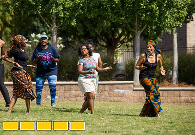 Toni Marie Young, far left, brown skirt, leads a Class on the Grass where she teaches traditional African dance during an Art on the Beltline event.  The Beltline activites now extends to the Westside Trail where family-friendly, free events include traditional African drumming lessons and performance, circus acts, live music and community empowerment opportunities are now available.  (Jenni Girtman / Atlanta Event Photography)