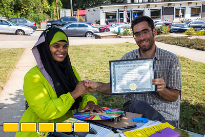 In Gordon White Park, Hujrah Wahhaj, left, is recognized for her community efforts by Ori Alon, who runs the Center for Supportive Democracy.  Art on the Beltline now extends to the Westside Trail where family-friendly, free events include traditional African dance lessons and performance, circus acts, live music and community empowerment opportunities are now available.  (Jenni Girtman / Atlanta Event Photography)