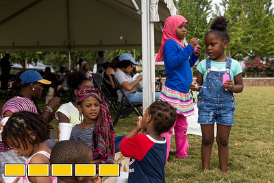 In Gordon White Park, Nawailah Ali, 7, standing pink headscarf, and Janiyah Larkin, right, play during an Art on the Beltline event.  These events now extends to the Westside Trail where family-friendly, free events include traditional African dance lessons and performance, circus acts, live music and community empowerment opportunities are now available.  (Jenni Girtman / Atlanta Event Photography)