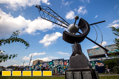 "Along the Eastside Beltline is ""Long Distance"" an interactive sculpture created by Nathan Pierce and moves with viewer interaction.  The Beltline continuing to evolve with new art installations, murals and sculptures.  (Jenni Girtman / Atlanta Event Photography)"