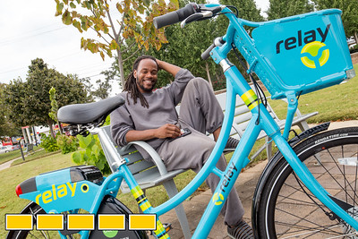 Shawn Walton, the founder of WeCycle, is is Gordon White Park with a Relay Bike Share bike, available for rent in front of his shop.  WeCycle is a bike shop and community center were footballs, yoga mats, toddler toys and bikes can be checked out.  The center is working with students from Morehouse college of Medicine to continue it's community efforts.  (Jenni Girtman / Atlanta Event Photography)