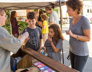 Derin Aytekin,11, left, Yaz Memecan, 7, and Derin's mother, Zeynep Aytekin try samples of Xocolatl Small Batch Chocolate at Morningside Farmers' Market.  The market is open every Saturday, year round, at 1393 N. Highland Ave. where organic meats, breads, local food, pop-up breakfast, coffee and fresh fruits and vegetables are available weekly.  (Jenni Girtman / Atlanta Event Photography)