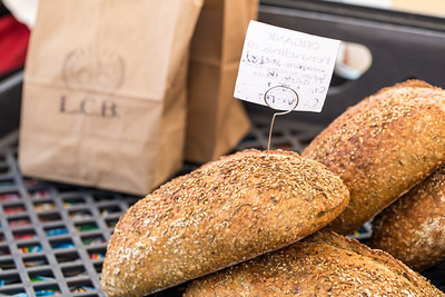 La Calavera Bakery's whole grain breads, pecan sticky buns and traditional Mexican treats are for sale at Morningside Farmers' Market.  The market is open every Saturday, year round, at 1393 N. Highland Ave. where organic meats, breads, local food, pop-up breakfast, coffee and fresh fruits and vegetale are available weekly.  (Jenni Girtman / Atlanta Event Photography)