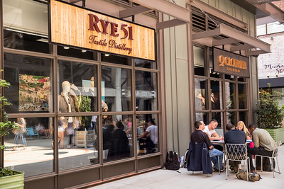 Ponce City Market is filled with shopping options including Rye 21, a luxury men's retailer offering dry goods, apparel and an in-store whiskey bar.  Shop are alongside coffee shops, indoor and outdoor dining and common areas for taking a break.  (Jenni Girtman / Atlanta Event Photography