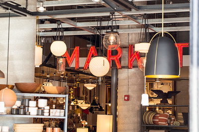 Ponce City Market is filled with shopping options including Rejuvenation, a specialty lighting and home parts store for historic homes.  Shop are alongside coffee shops, indoor and outdoor dining and common areas for taking a break.  (Jenni Girtman / Atlanta Event Photography
