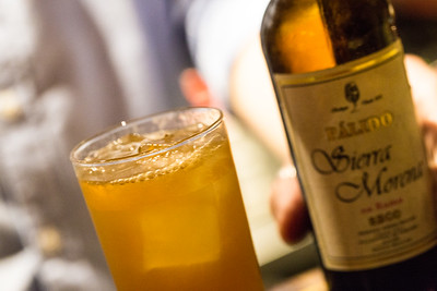 Greg Best mixes cider, brandy, bitters and tops the cocktail with sherry to create an old brick wall for pairing with oysters gratin at Ticonderoga Club in Krog Street Market.  (Jenni Girtman / Atlanta Event Photography)
