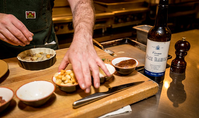 Chef and Partner David Bies prepares oyster grain cooking with sherry in the kitchen at Ticonderoga Club in Krog Street Market. The dish is paired with an old brick wall, a cocktail of cider, brandy, bitters and topped with sherry.  (Jenni Girtman / Atlanta Event Photography)