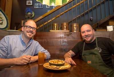 Bartender and partner Greg Best, left, and Chef and partner David Bies, right, pair oysters gratin with an old brick wall cocktail at Ticonderoga Club in Krog Street Market.   (Jenni Girtman / Atlanta Event Photography)