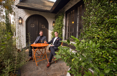 The private Virginia Highlands home of Paul Durick, left, and his roommate Jon Pennycuff, right, is at the corner of Monroe Drive and Amsterdam Ave.  The roommates are on the front patio at the Cape Dutch style home.  (Jenni Girtman / Atlanta Event Photography)