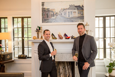 The private Virginia Highlands home of Paul Durick, right, and his roommate Jon Pennycuff, left, is at the corner of Monroe Drive and Amsterdam Ave.  The roommates display sentimental items, including New Orleans art and shoes.  The shoes are given out at the New Orleans Krewe of Muses parade.  Shoes are passed out  like beads at Mardi Gras.  (Jenni Girtman / Atlanta Event Photography)
