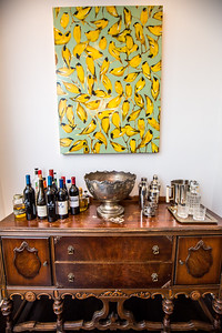 The private Virginia Highlands home of Paul Durick and his roommate Jon Pennycuff is at the corner of Monroe Drive and Amsterdam Ave.  The wet bar is a piece of furniture from Pennycuff's childhood home, which burned, leaving few items, including this buffet.  (Jenni Girtman / Atlanta Event Photography)