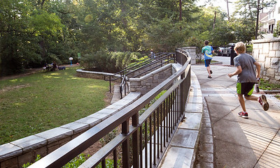 Orme Park in Virginia Highlands runs along Brookridge Drive and has a playground on one side of Clear Creek and a natural path on the other side.  The park is filled with kids toys and is heavily used by dog walkers, families and runners.  (Jenni Girtman / Atlanta Event Photography)
