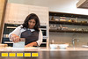 Chef Asha Gomez prepares a traditional dish at her restauranrt Spice to Table in Atlanta.