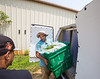 King of Crops is a working farm still in its beginning stages.  Stephen Dobek, is packing freshly picked basil into a truck headed to Atlanta.  Dobeck manages the farm in Winston, GA where ingredients for King of Pops will be sourced.  Some crops, like basil and blackberries, already are part of the pops production.  (Jenni Girtman / Atlanta Event Photography)