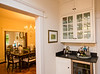 On the tour of homes, this Virginia-Highlands home has been restored and expanded.  The original floors and windows are charming and the original pocket doors and fireplaces are beautifully complimented by the new kitchen and back screened in porch.  Browning Jeffries and her husband are welcoming people into their house during the annual tour in Virgina Highlands.  (Jenni Girtman / Atlanta Event Photography)