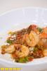 Chef Jennifer Hill Booker prepares Shrimp n Grits in her kitchen.