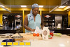 Chef Jennifer Hill Booker prepares Shrimp n Grits in her kitchen.