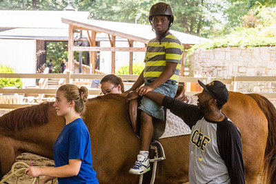 Nathan Benefield, 22, learns a few basics of horseback riding at Chastain Horse Park where his special needs camp, Camp Best Friends, has several classes.  The center provides therapeutic programs for special needs campers and for those in need of physical and occupational therapies.  The program is comprised of professional therapist, equestrians and volunteers.    (Jenni Girtman / Atlanta Event Photography)