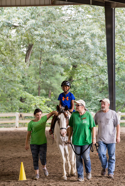 Allen Strong, 7, learns a few basics of horseback riding at Chastain Horse Park where his special needs camp, Camp Best Friends, has several classes.  The center provides therapeutic programs for special needs campers and for those in need of physical and occupational therapies.  The program is comprised of professional therapist, equestrians and volunteers.    (Jenni Girtman / Atlanta Event Photography)