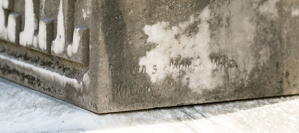 Many of the craftsman who work in marble and granite headstones mark their work, as is seen here, this stone is from a Marietta craftsman who worked on the Powell gravestone in the old section of the graveyard.  (Jenni Girtman / Atlanta Event Photography)
