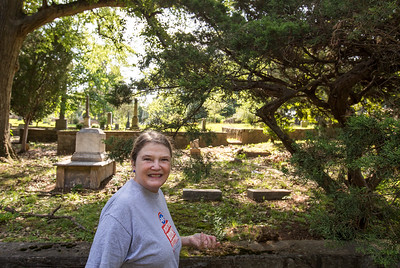 Cathy Vogel, president of the Friends of Decatur Cemetery, shares the history of Dr. Thomas Holley Chivers, also knows as the Lost Poet of Georgia.  Chivers was a friend of Edgar Allan Poe through literary circles of the time, their works of the mid 1800s have distinctive similarities.  (Jenni Girtman / Atlanta Event Photography)