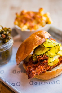 At the pop-up restaurant Oddbird, chicken biscuits can be served with cole slaw, mac and cheese and country ham collard greens.  The fried chicken is offered plain, hot, pictured here, or too hot (for the spicy fans).  Oddbird is found popping up at West Egg off Howell Mill on the second Wednesday. (Jenni Girtman / Atlanta Event Photography