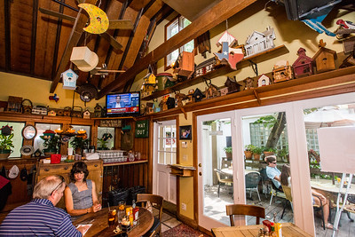 Treehouse Restaurant and Pub is tucked in to the Peachtree Hills neighborhood.  The 30-year-old establishment offers a constant rotation of craft beers, burgers and pub food and a full bar, as well as a large outdoor patio that is dog friendly and casual.  (Jenni Girtman / Atlanta Event Photography)