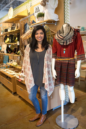 Meghna Dave block-prints cotton scarves, tunics and kimonos by hand.  Her designs are for sale at The Beehive on Caroline St. in the Edgewood Retail District.