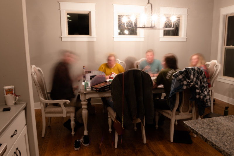 A group of students sit at a dining room table in a house off-campus to play a board game with snacks readily available. A large number of students at K-State live off-campus in various housing types, some houses-for-rent, some live in aparment complexes. The housing available is also located in a vast area around campus and within the Manhattan community. (Olivia Bergmeier | Collegian Media Group)