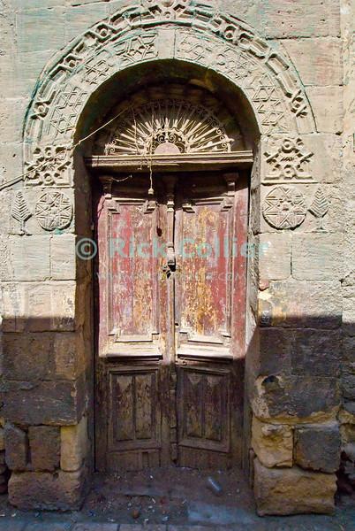 Cairo, Egypt -- An old door in Coptic Cairo. © Rick Collier / RickCollier.com.<br /> <br /> <br /> <br /> <br /> <br /> travel; vacation; tour; tourism; tourist; destination; Egypt; Cairo; door; wall