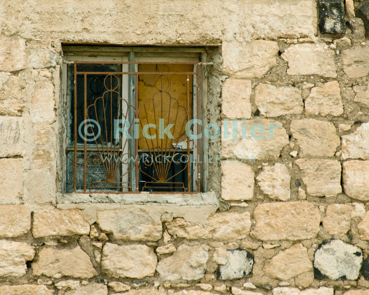 Umm Qais, northwestern Jordan.  Ornate grates secure a window in the museum at Gadara.  © Rick Collier<br /> <br /> <br /> <br /> Jordan 'Umm Qais' Ottoman Roman Gadara Gadarenes Bible Biblical ruin ruins 'ancient world' archeology 'archeological site' window antique