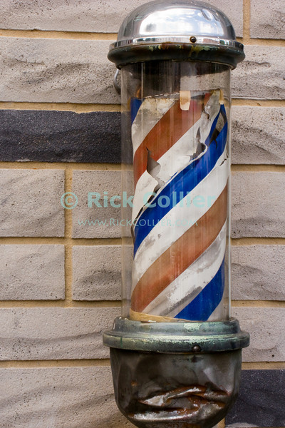 Disused sign pole, closed barbershop, Winchester, Virginia.  © Rick Collier