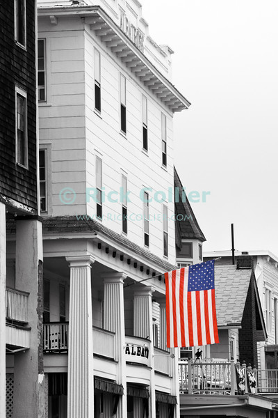 """""""Hotel Flag"""" - An American flag flies in front of the old Albatross Hotel in central Ocean Grove, New Jersey, USA.<br /> <br /> <br /> USA """"New Jersey"""" NJ """"Ocean Grove"""" Ocean Grove main street town center Albatross Hotel American flag US flag"""