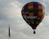 "A hot air balloon clears the flagpole at the annual Winchester Balloon Festival.  Long Branch Farm, Winchester, Virginia, USA.  © RickCollier.com<br /> <br /> <br /> <br /> <br /> <br /> ""balloon festival""; USA; Virginia; Winchester; ""Long Branch""; ""Long Branch Farm""; balloon; lift; ""balloon lift""; dawn; sunrise; flag; flagpole; ""flag pole""; sky; fly; flight;"