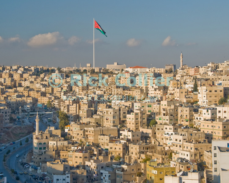 The worlds tallest free-standing flag pole (topped by what must be one of the largest flags) overlooks Amman, Jordan.  © Rick Collier<br /> <br /> <br /> <br /> <br /> <br /> <br /> Jordan Amman Rome city Islamic buildings apartments 'city center' street mosque minaret skyline flag flagpole city panorama panoramic view