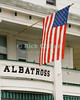 """Hotel Flag"" - An American flag flies in front of the old Albatross Hotel in central Ocean Grove, New Jersey, USA.<br /> <br /> <br /> USA ""New Jersey"" NJ ""Ocean Grove"" Ocean Grove main street town center Albatross Hotel American flag US flag"