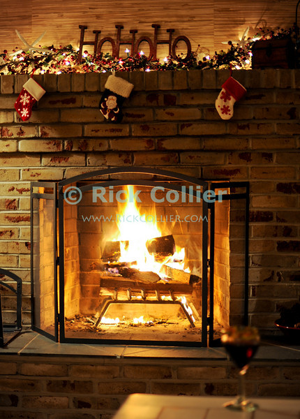 "Christmas Fireplace, 2009.  © Rick Collier<br /> <br /> <br /> <br /> Fireplace fire hearth mantle decor decoration ""Ho Ho Ho"" lights wine ""wine glass"" glass Christmas Xmas holiday celebration"