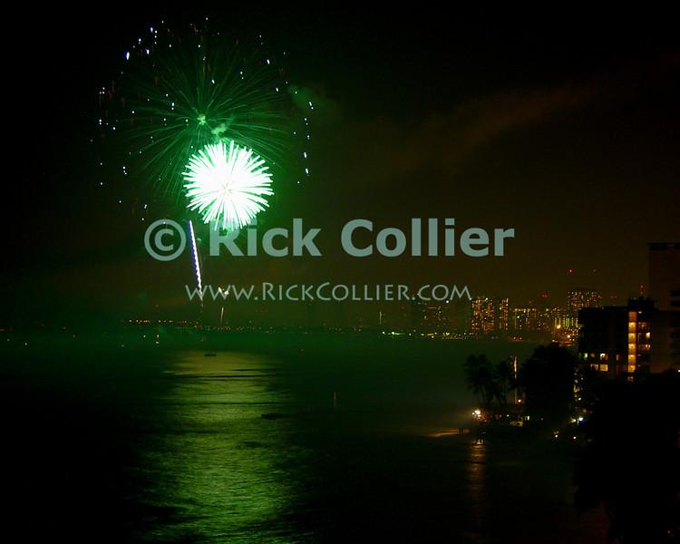 Fireworks celebrate the New Year.  Waikiki, Honolulu, Oahu, Hawaii.  © Rick Collier<br /> <br /> <br /> <br /> <br /> <br /> <br /> <br /> Hawaii Hawai'i Oahu Honolulu Waikiki after dark night fireworks firework bay lights harbor New Year celebration