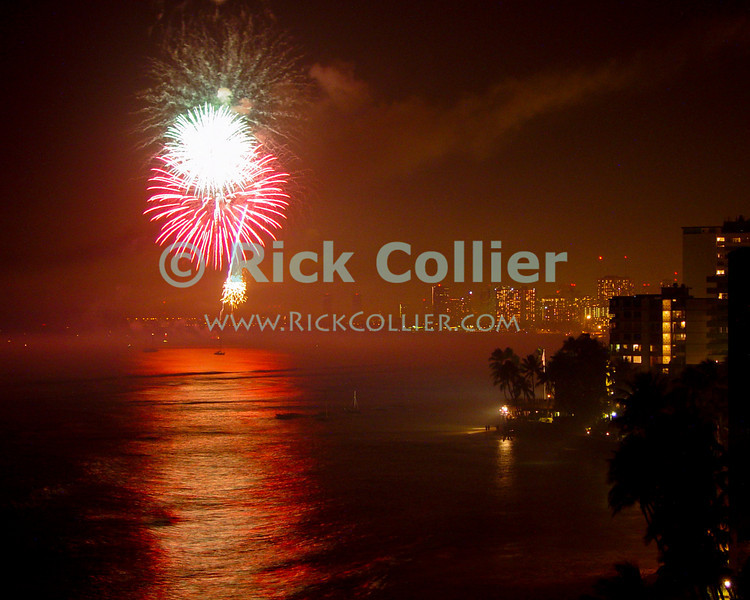 Fireworks celebrate the New Year.  Waikiki, Honolulu, Oahu, Hawaii.  © Rick Collier<br /> <br /> <br /> <br /> <br /> <br /> <br /> <br /> Hawaii Hawai'i Oahu Honolulu Waikiki after dark night fireworks firework bay lights harbor New Year celebration