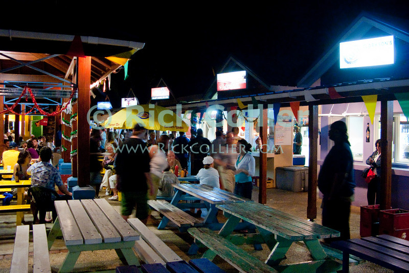 """Oistins, Barbados -- The Oistins fish fry is a destination for good food and local color every Friday night on the west (lee) side of Barbados.<br /> <br /> <br /> <br /> <br /> Barbados; Oistins; fish; food; """"fish fry""""; bazaar; market; night; lights; food; dining; dark;"""