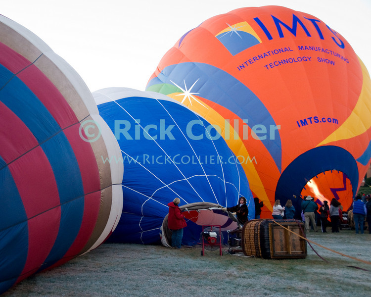 """""""Early Birds"""" -- Crews labor to inflate balloons on a frosty early morning, just after dawn at the annual Winchester Balloon Festival.  Long Branch Farm, Winchester, Virginia, USA.  © RickCollier.com<br /> <br /> <br /> <br /> <br /> <br /> """"balloon festival""""; USA; Virginia; Winchester; """"Long Branch""""; """"Long Branch Farm""""; dawn; morning; balloon; lift; """"balloon lift""""; mist; fog; frost; inflate;"""