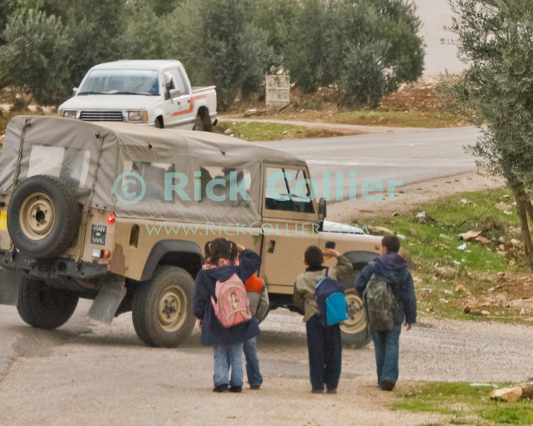 Jordan - Small children frequently come to attention and salute -- showing huge smiles -- whenever they see a military vehicle.  © Rick Collier<br /> <br /> <br /> <br /> Jordan jeep landrover military army child children salute play fun